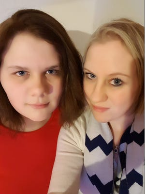 Morgan Sellers, 14, with her mom, Alisha Morton, 31, of Ankeny. Morton said her daughter has been the victim of bullying at Northview Middle School.