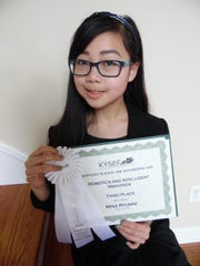 Mina Ryumae, of Gray Middle School, studied whether a computer prefers certain tones of music like humans do.
