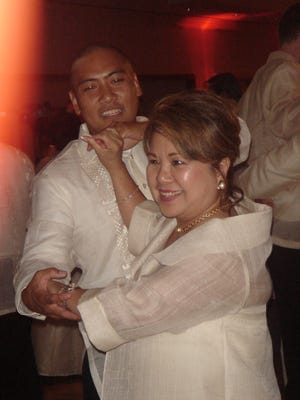 Edna Rebanal, right, and Tristan Rebanal are pictured dancing during family member John Aldo Rebanal's wedding reception on July 8, 2006 in Los Angeles.
