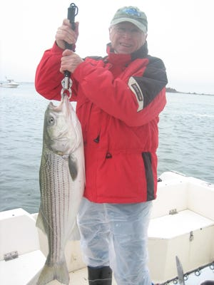 Jim Soch of West Windsor with an 18-pound striped bass.