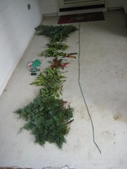Lay out your yarn template, then work to fill it in with your cut greenery. Wire if required with floral wire.