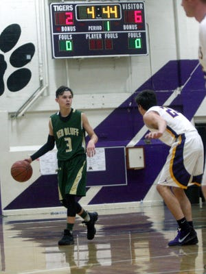 Red Bluff's Brayden Hutchins, left, dribbles the ball in the Oroville tournament championship against Lassen on Saturday.