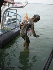 Detroit Police Department diver Sgt. Michael Carpenter discovered this statue while recovering a vehicle from the Detroit River. The piece, believed to have been stolen, was transferred to the Grosse Pointe War Memorial in Grosse Pointe Farms, where it originally was part of the fountain. The photo is dated May 6, 2009.