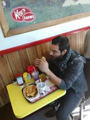 Mickey Davis enjoys his last Kay's meal.
