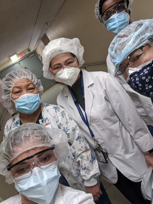 Jennifer Emmons (front left) is seen with others in the nursing administration at Bergen New Bridge Medical Center in New Jersey.