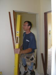 Bill Pelishek, finish carpenter for Kwaterski Construction, works on a door in a custom home at Polo Point subdivision in Hobart. Polo Point is see activity after getting new owners and a change in direction.
