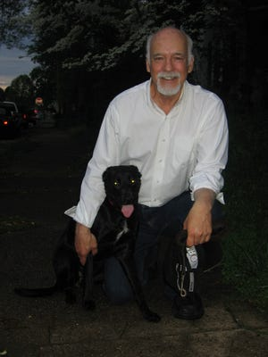 Asa Caron's family says he was a healthy and vigorous 69-year-old before he suddenly suffered an intestinal issue in 2011. This photo, with his dog, Sheba, was taken about a month before he went to the VA hospital in Huntington, W.Va., where he was treated by former Des Moines surgeon Robert Finley III.