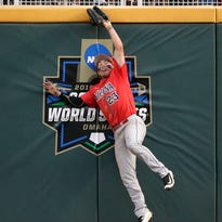 Arizona right fielder Zach Gibbons catches a fly ball in the eighth inning of game one of the NCAA College World Series finals.
