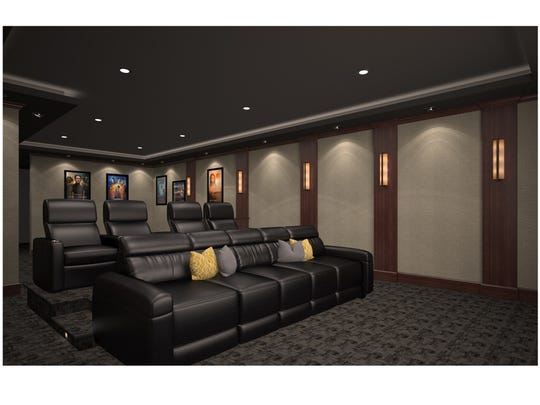 Luxurious leather seating, theater decor and professioanl lighting are hallmarks of this home theater by Acadian Home Theaters and Automation.