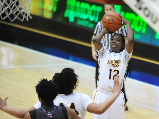 Southern Miss' Brittanny Dinkins shoots toward the basket Monday against William Carey at Reed Green Coliseum.