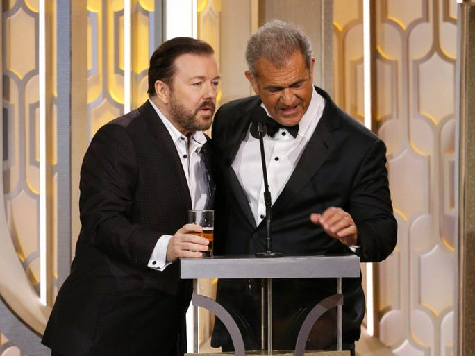 Host Ricky Gervais, left, and Mel Gibson appear on stage at the 73rd Annual Golden Globe Awards at the Beverly Hilton Hotel in Beverly Hills, Calif., on Sunday, Jan. 10, 2016.