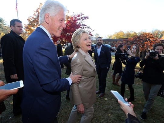 Former President Bill Clinton and Hillary Clinton greet the crowd at the Douglas Grafflin Elementary School in Chappaqua after casting their votes Nov. 8.
