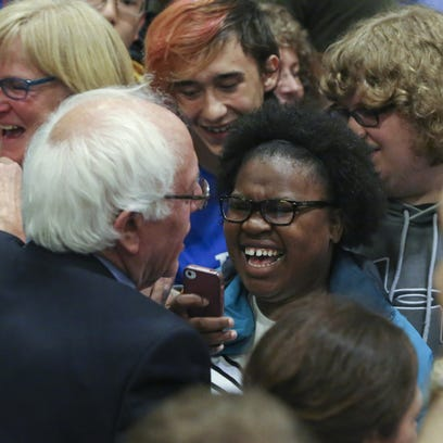 Bernie Sanders is greeted following a rally at Chase