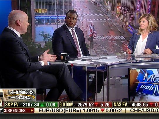From left: Gerard Baker, Editor-in-Chief of Dow Jones