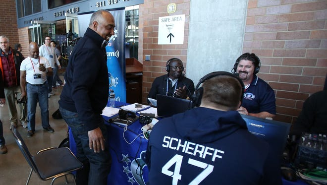 Cincinnati Bengals coach Marvin Lewis after finishing an interview talks to Iowa Hawkeyes offensive linemen Brandon Scherff during the 2015 NFL Combine at Lucas Oil Stadium