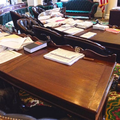 The desk of Sen. Norm McAllister, R-Franklin, was cleared