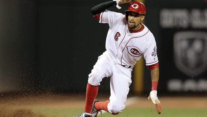 Cincinnati Reds center fielder Billy Hamilton (6) slides in safely, stealing third in the bottom of the eighth inning of the MLB National League game between the Cincinnati Reds and the St. Louis Cardinals at Great American Ball Park on Tuesday, June 7, 2016.