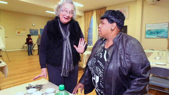 Rev. Lynda Clements, left, and Pearl Peterson, executive director, during the Breaking the Chains of the Past program at the Ossining Presbyterian Church March 5, 2014. The program helps former inmates acclimate into society.