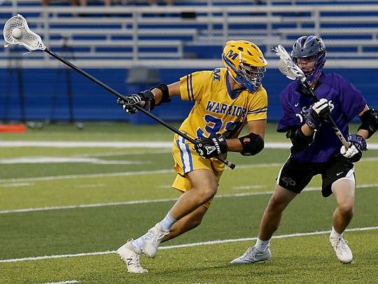 Mariemont defender Charlie Cowart tries to elude DeSales defender Jack Ayers during their Division II boys lacrosse state semifinals at Roger Glass Stadium in Dayton Tuesday, May 29, 2018.