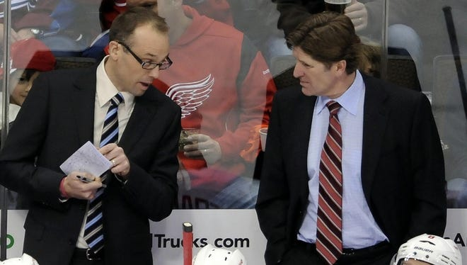 Detroit Red Wings head coach Mike Babcock, right, and assistant coach Jeff Blashill talk against the Colorado Avalanche at the Pepsi Center.