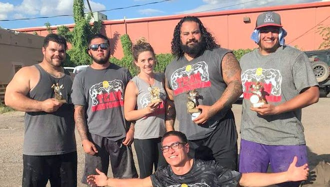 Iron Works Gym in Silver City took seven people to compete at the Dog Days Strongman Competition in Las Cruces and brought back five trophies. From left, are Robert Hartwell, Caesar Sierra, Kaitlin Moulton, Jeremy Gonzales, Robert Carrasco, and kneeling is Tavin Arredondo. Not pictured is Victor Oaxaca.