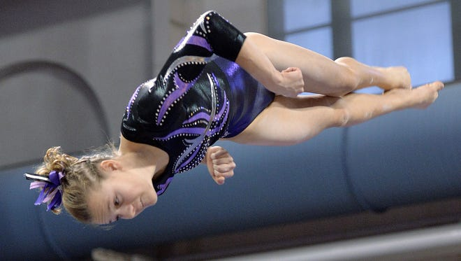 Melrose sophomore Mady Brinkman performs on the balance beam during the team competition portion of the Class A girls gymnastics state meet at the University of MinnesotaÕs Sports Pavilion in Minneapolis.