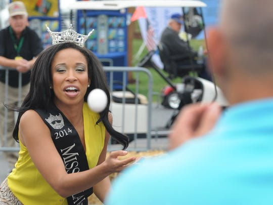 Miss Delaware 2014 Brittany Lewis, who gained the crown after its original winner was disqualified for being too old, has been fulfilling the role of the state's official hostess, including joining Gov. Jack Markell in the egg toss on Governor's Day at the Delaware State Fair last year in Harrington.