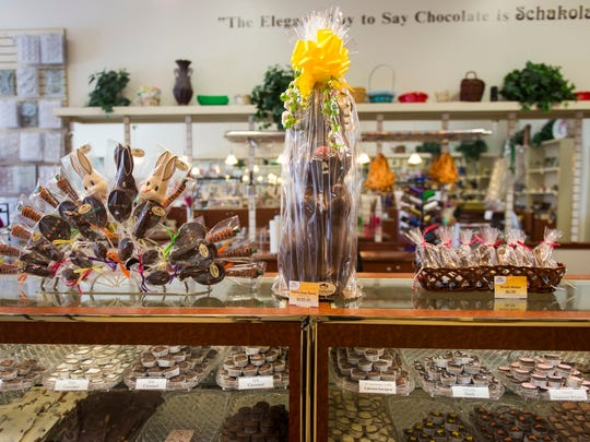 A 21-inch, 5-pound hollow milk chocolate bunny, center, sold at Schakolad Chocolate Factory on Thursday, March 30, 2017.