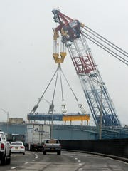 The Left Coast Lifter places a girder assembly in place