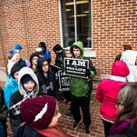 Young protesters hold signs during a Pro-Life prayer rally in downtown Gettysburg on Jan. 22, 2016 in front of the Adams County Courthouse.