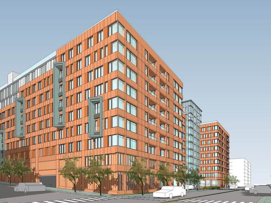 An artist's rendering of an apartment building proposed