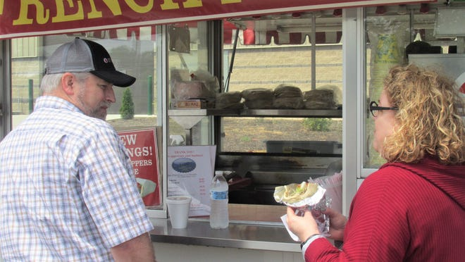 Wayne Yingling and Jennifer Rock of Medina stopped by Linn's Gyros for some good, old fashioned fair food Saturday outside the event center at the Wayne County Fairgrounds. A couple of food trucks each weekend will be serving up grub as the vendors try to get their businesses back up and running strong.