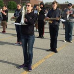 Members of the Centerville High School Blue Regiment practice for their upcoming performance at the 500 Festival Parade on Saturday in Indianapolis.