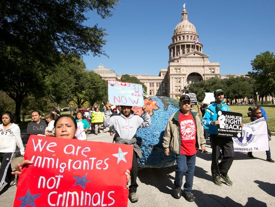 Protesters march at the Texas state Capitol in Austin