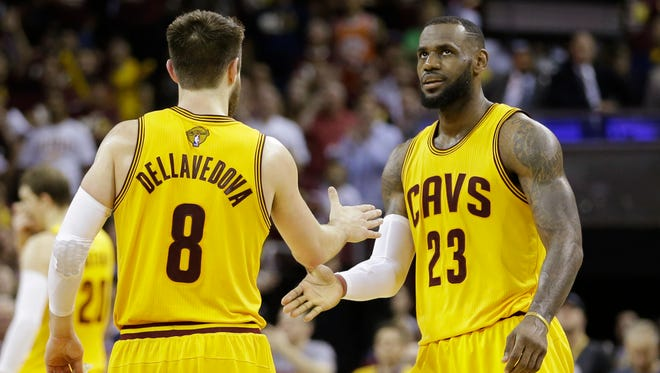 Cleveland Cavaliers forward LeBron James (23) celebrates with teammate Matthew Dellavedova during the second half of Game 3 of basketball's NBA Finals against the Golden State Warriors in Cleveland, Tuesday, June 9, 2015.