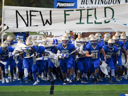 The Huntingdon High School Mustangs runs through a