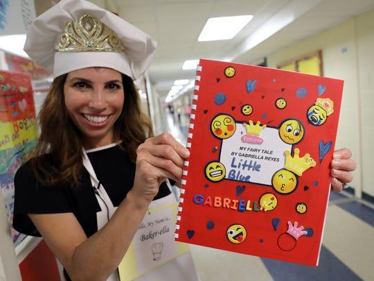 Third-grade teacher Karen Davis holds a fairy tale