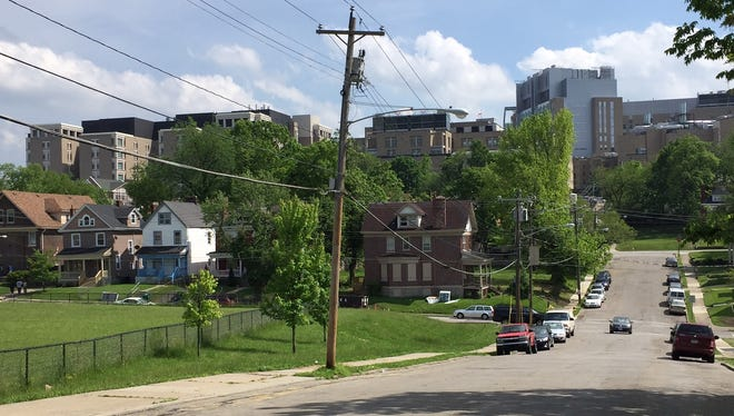 Cincinnati Children's Hospital Medical Center, shown from Wilson Avenue, Avondale, is pledging to invest $11.5 million in the neighborhood over the next five years.