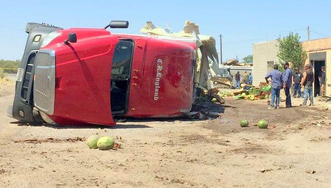 A semi carrying a load of watermelons flipped in nearly the same spot as a previous similar accident near the motorcycle shop of the mayor.