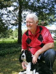 Donald Hixson, 68, of Pinckney, Mich. is with his dog
