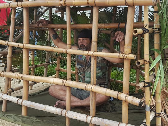 "Raymond ""Little Brother"" Dionne sat in a bamboo cage as a living memorial to those who lost freedom while fighting for it."