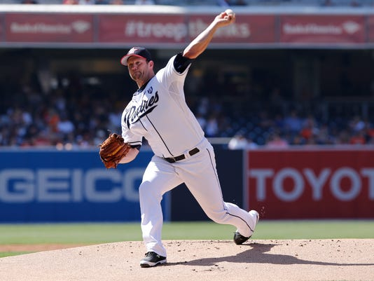 San Diego Padres starting pitcher Eric Stults throws against the San Francisco Giants during the first inning of a baseball game on Friday, July 4, 2014, in San Diego. (AP Photo/Don Boomer)