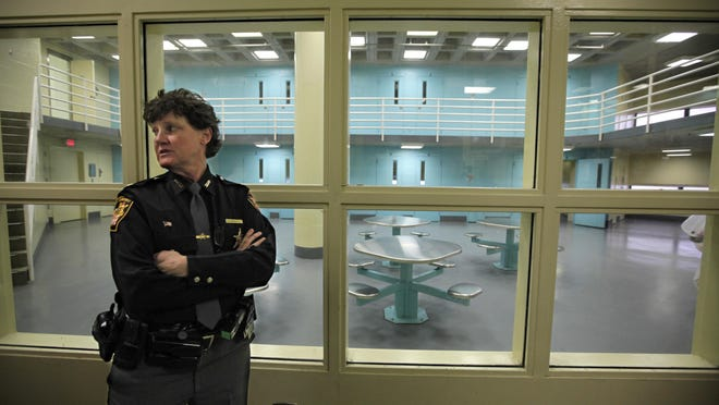Maj. Charmaine McGuffey, who ran the Corrections Division, stands in front of one of the regular units at the Hamilton County Justice Center.