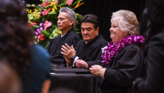 In this January 2017 file photo, Supreme Court of Guam justices are shown during the installation ceremony of Associate Justice of Guam Katherine A. Maraman as the first female chief justice of Guam. From left are Associate Justice F. Philip Carbullido, Associate Justice Robert Torres, and Maraman.