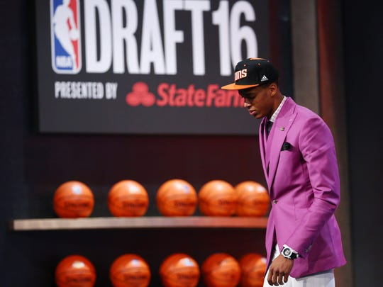 Jun 23, 2016; New York, NY, USA; Skal Labissiere (Kentucky) walks off stage after being selected as the number twenty-eight overall pick to the Phoenix Suns in the first round of the 2016 NBA Draft at Barclays Center. Mandatory Credit: Jerry Lai-USA TODAY Sports ORG XMIT: USATSI-269318 ORIG FILE ID: 20160623_jel_sl8_216.jpg