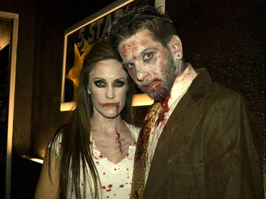 Reno residents break out their best zombie costumes for the 2016 Reno Zombie Crawl on Oct. 22.