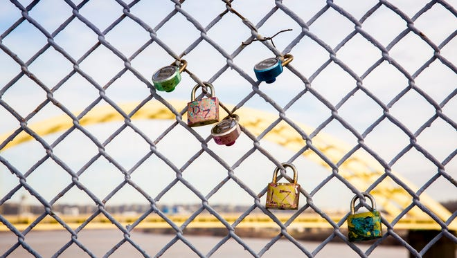 The organization that manages and owns the Purple People Bridge is considering creating a new display for the locks that won't interfere with bridge maintenance. That's because, despite a love lock ban, couples are still fastening locks to the bridge's railings.