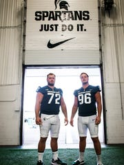 MSU sophomore DT Mike Panasiuk, left, and DE brother