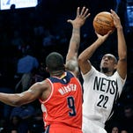 Brooklyn Nets guard Markel Brown (22) goes to the basket past Washington Wizards forward Martell Webster (9) during the second half of an NBA basketball game, Friday, April 10, 2015, at New York. The Nets won 117-80. (AP Photo/Mary Altaffer)