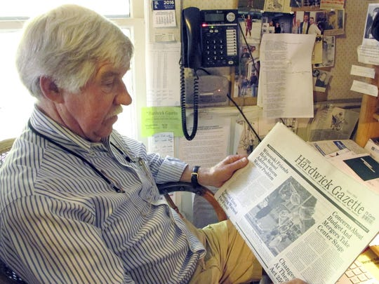 Ross Connelly, owner of the Hardwick Gazette weekly newspaper, holds a copy of the paper in his office earlier in 2016.